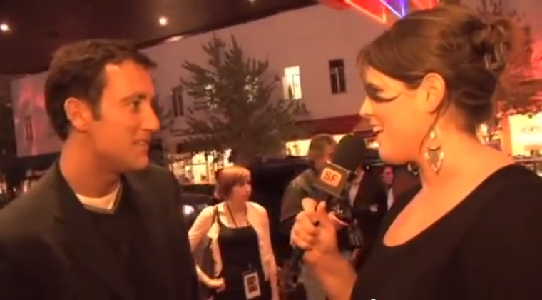 Screenshot from that time I interviewed Clive Owen! The sidewalk was slanted so to my horror, I appear taller than Clive, which was not the case. (VidSF/SFAppeal)